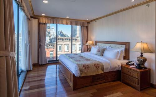 A bed or beds in a room at The Allen Hotel