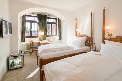 Ein Bett oder Betten in einem Zimmer der Unterkunft Hotel Deutscher Kaiser