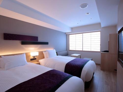 京都四條新町穎特飯店房間的床
