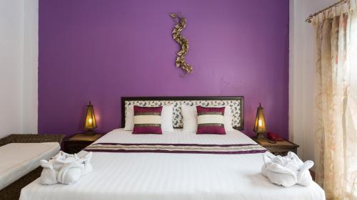 A bed or beds in a room at PloyKhumThong Boutique Resort