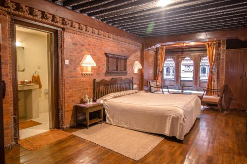 A bed or beds in a room at Kantipur Temple House