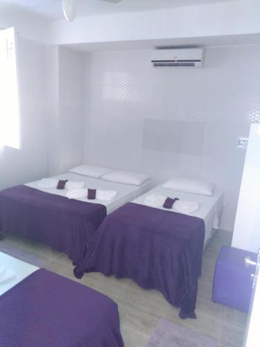 Cama ou camas em um quarto em Hotel Pousada Papaya Verde