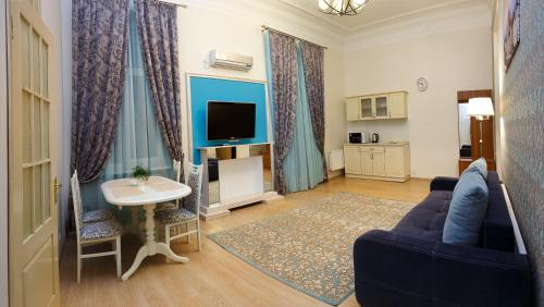 """A seating area at Apartment on Sumskaya 46 """"Family"""""""