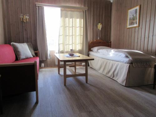 En eller flere senger på et rom på Toftemo Turiststasjon