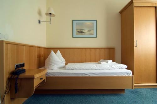 Ein Bett oder Betten in einem Zimmer der Unterkunft Hotel Berlin - GreenLine Hotel