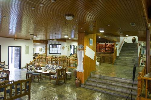 A restaurant or other place to eat at Dionyssos