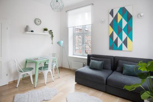 Część wypoczynkowa w obiekcie Apartament Miętowy | Chill and the City Apartments