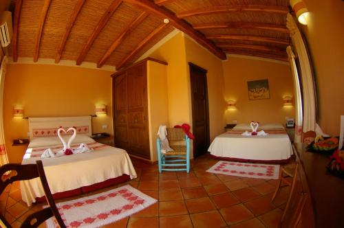 A bed or beds in a room at Santa Maria Resort