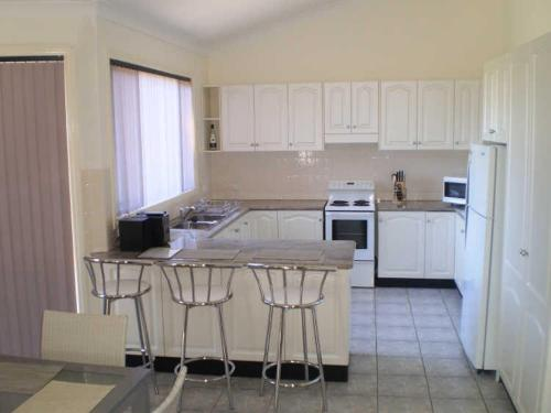 A kitchen or kitchenette at Retreat on Surf Beach