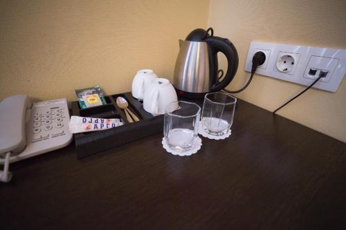 Принадлежности для чая и кофе в Hotel Argo