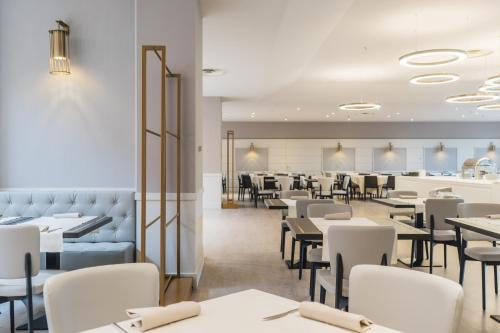 A restaurant or other place to eat at Best Western CTC Hotel Verona