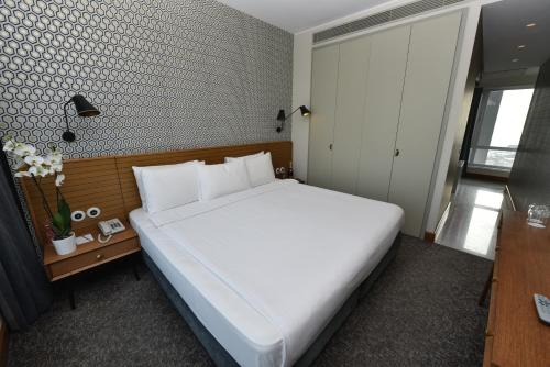 A bed or beds in a room at The Marmara Pera