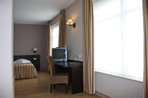 Телевизор и/или развлекательный центр в Hotel Giorgi