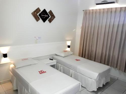 Кровать или кровати в номере Hotel Planalto 2