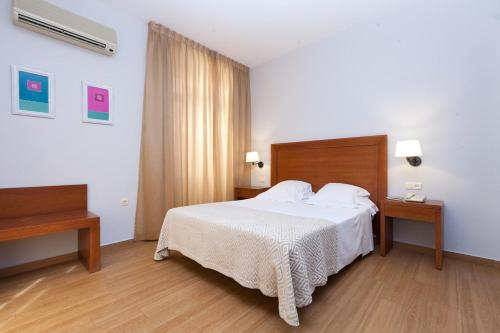 A bed or beds in a room at Venecia