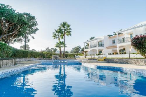 The swimming pool at or near Pine Cliff Apartment by The Portuguese Butler