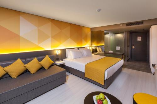 A bed or beds in a room at Bosphorus Sorgun Hotel
