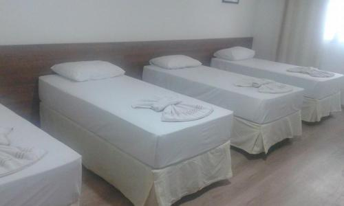 A bed or beds in a room at Cometa Palace Hotel