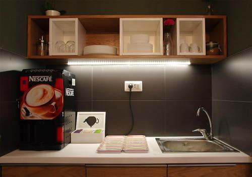 A kitchen or kitchenette at Up.Cooltura Guesthouse