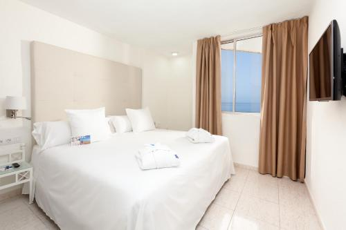 Cama o camas de una habitación en Sol Arona Tenerife