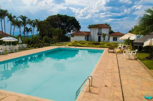 The swimming pool at or near VOA Mirante Do Café
