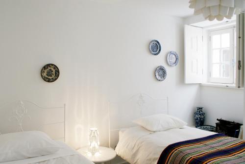 A bed or beds in a room at Casa de Baixo
