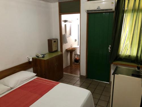 A bed or beds in a room at Pousada da Orla