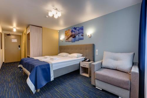 Voodi või voodid majutusasutuse Noorus SPA Inn toas