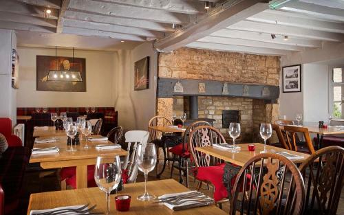 A restaurant or other place to eat at The Churchill Arms