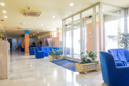 The lobby or reception area at Hotel Bezana Lago