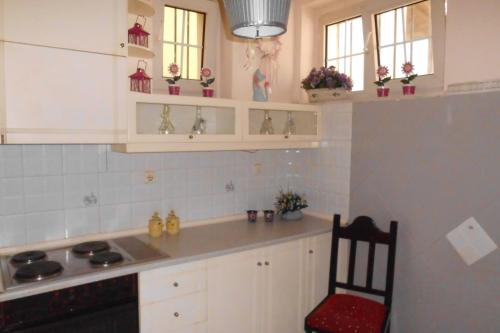 A kitchen or kitchenette at Thessaloniki Airport Apartment & Mall Cosmos