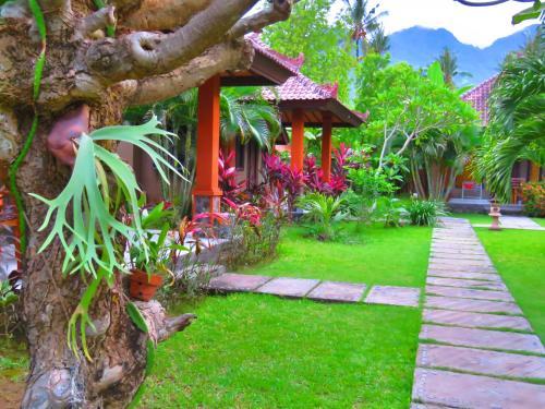 A garden outside Suka Sari Cottages