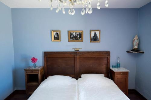 A bed or beds in a room at B&B Candelária