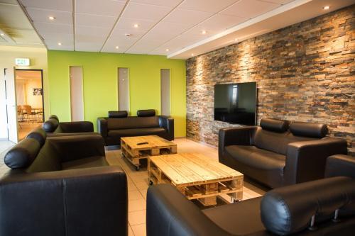 Ein Sitzbereich in der Unterkunft YOUTEL - Jugendhotel Bitburg