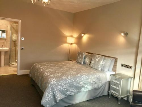 A bed or beds in a room at Bromwell Court