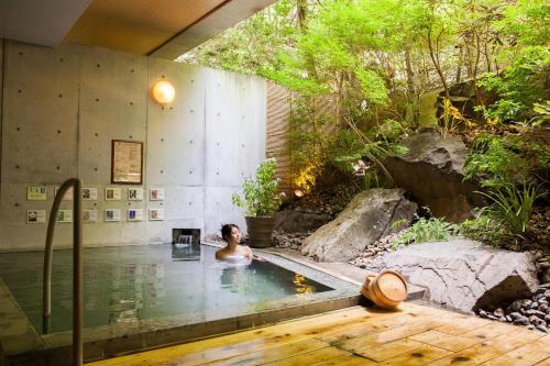 The swimming pool at or near Izumigo Neo Oriental Resort Yatsugatake Kogen