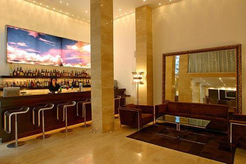 The lounge or bar area at Alassia Hotel