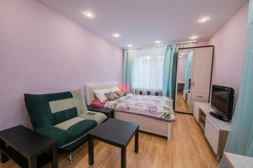 Гостиная зона в Apartments at bulvar Novatorov 110