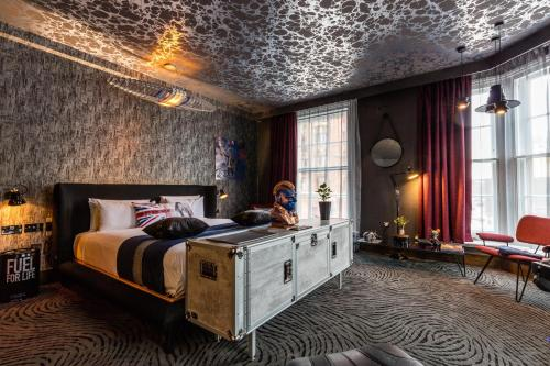 A bed or beds in a room at Megaro Hotel