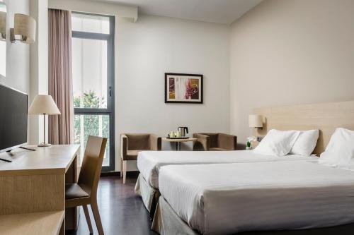 Cama o camas de una habitación en Hotel Exe Barcelona Gate