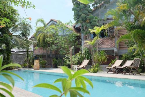 The swimming pool at or near Panji Panji Tropical Wooden Home