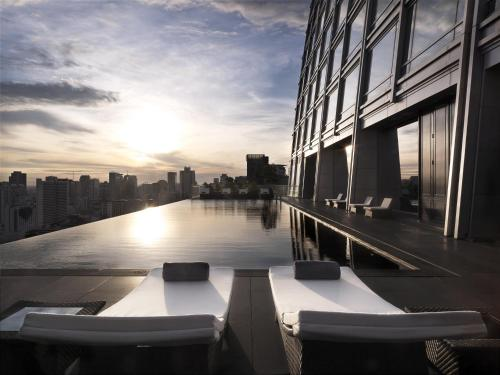 The swimming pool at or near The Okura Prestige Bangkok