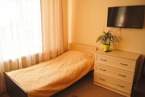 Кровать или кровати в номере Отель 104 комнаты