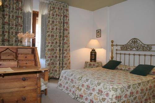 A bed or beds in a room at La Posada de Don Mariano