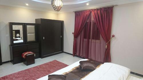 Cama ou camas em um quarto em Taraf Al Asalah Villas