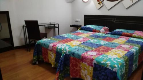 A bed or beds in a room at Santa Clara