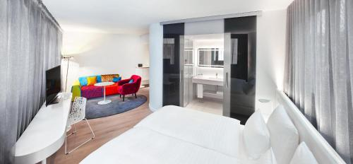 A bed or beds in a room at Jaz in the City Stuttgart