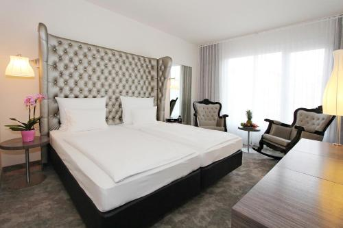 A bed or beds in a room at ARCOTEL John F Berlin