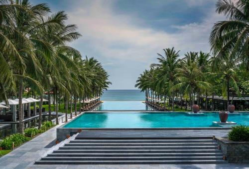 The swimming pool at or close to Four Seasons The Nam Hai, Hoi An, Vietnam