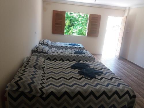 A bed or beds in a room at Hotel e Pousada O Casarão